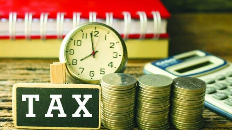 FM says corporate tax for cos to be cut gradually