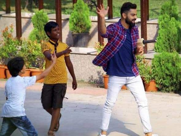 Image result for virat-kohli-spotted-playing-gully-cricket-ahead-of-indore